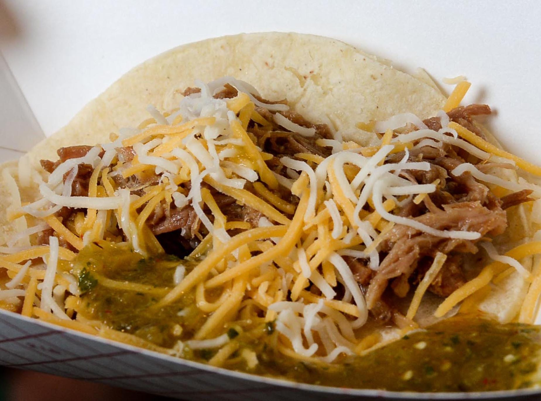 A pork taco with cheese from Taqueria El Taco of Anderson during the Anderson Area YMCA Ralph Hayes Toyota Taste of Anderson at The Bleckley Station Tuesday. Proceeds from the Aloha theme party benefit programs and services of the Anderson Area YMCA.