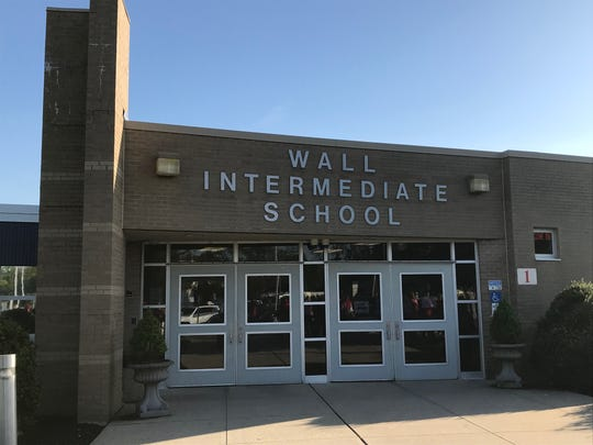 Educators and residents met at Wall Intermediate School on Tuesday to protest the renewal of Superintendent Cheryl Dyer's contract.