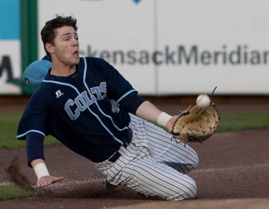 CBA right fielder Braedin Hunt makes a sliding catch in foul territory for an out in the third inning Tuesday night in CBA's 8-1 win over Ocean in the Monmouth County Tournament championship game.