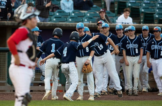 CBA players celebrate their second and third runs in the third inning as Anthony Celestre and Mason Wolf cross home plate. Christian Brothers Academy dominates Ocean Township in Monmouth County Baseball Final in Lakewood on May 7, 2019,