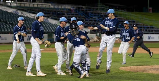 CBA players celebrate winning the Monmouth County Tournament championship Tuesday night.