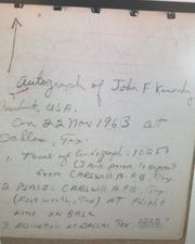 A notebook page describes the details of what's believed to be the last autograph signed by President John F. Kennedy before he was assassinated