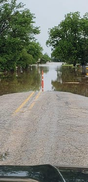 Water covered Farm to Market Road 1235 in Merkel early Wednesday.