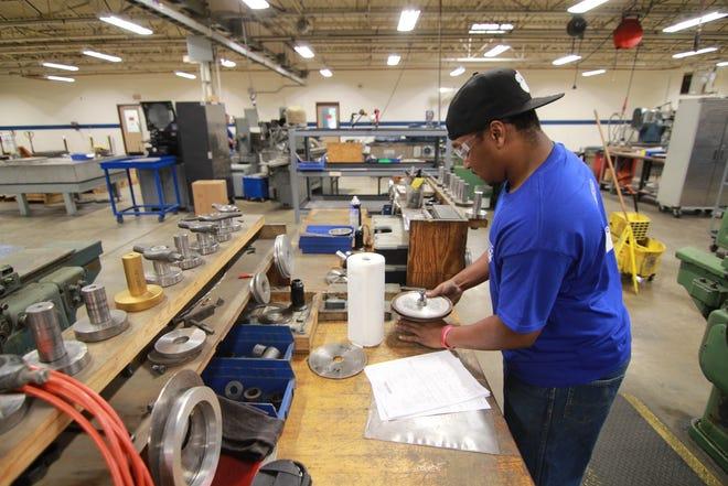 Juawon King works with a grinder wheel inside Advanced Superabrasives shop floor.