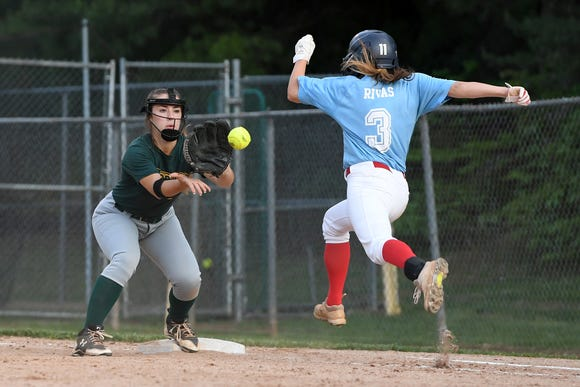 Reynolds' Lauren Wright makes a play at first base against Charlotte Catholics Peyton Rivas during their 3A playoff game at Reynolds High School on May 7, 2019. The Rockets won 4-3 to advance.