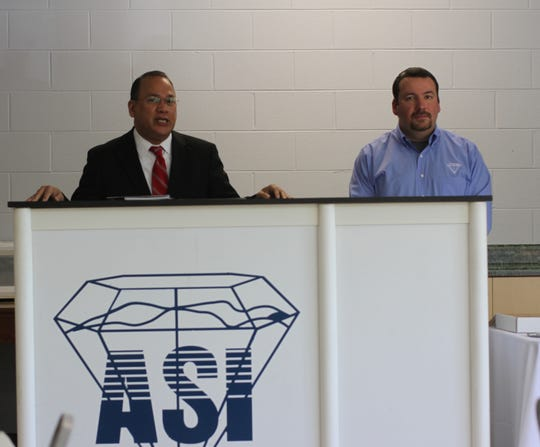 Michael Arriola, deputy district director with the U.S. Small Business Administration, presented Jonathan Szucs, general manager of Advanced Superabrasives, with the award for North Carolina's exporter of the year inside the company's Mars Hill headquarters May 8.
