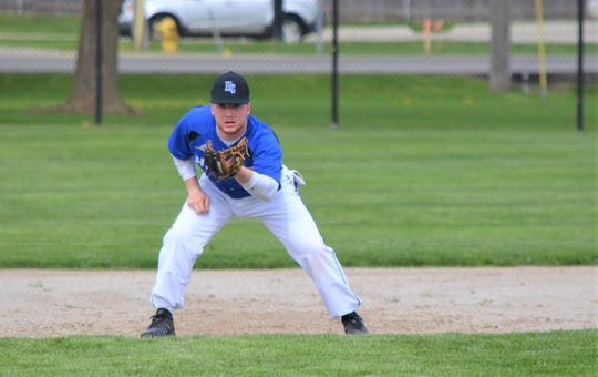 Harper Creek's Sam Bussler, who tore his ACL in the first game of the football season, has now made a full comeback to play baseball for the Beavers this spring.
