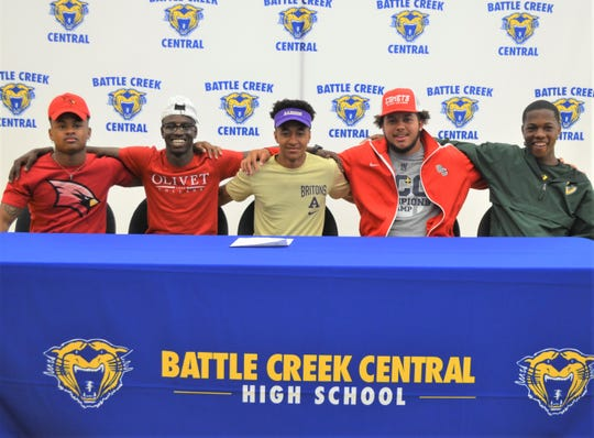 Five Battle Creek Central football players committed to play in college at a celebration on Wednesday, making the total of seven from last year's team that will play at the next level. From left, Josh Mann (Saginaw Valley), Mo Ahamed (Olivet College), Juara'e Robinson (Albion College), John Love (Olivet College), Siryan Brown (Wayne State).