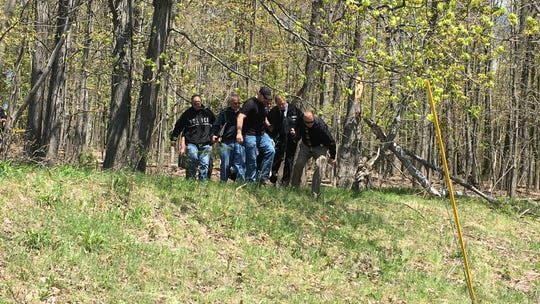 Authorities investigate the discovery of human remains in Johnson City.