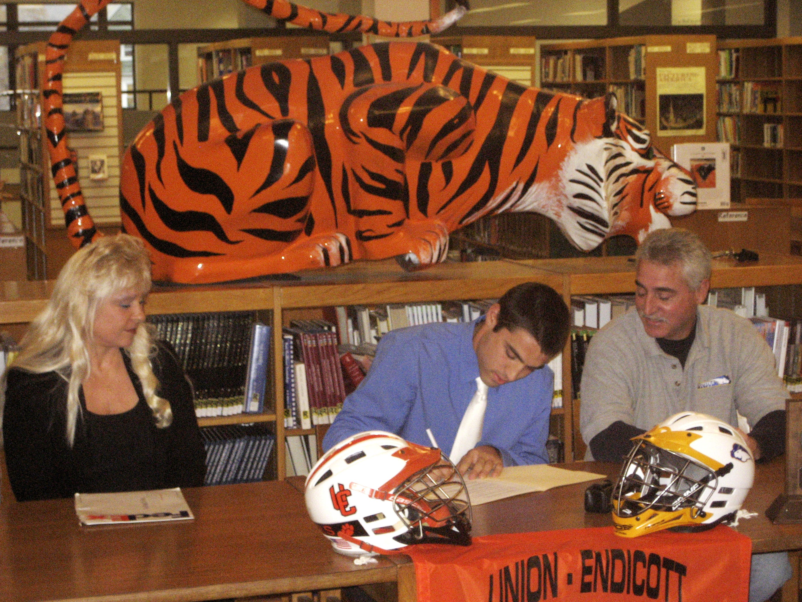 2007: Union-Endicott senior Daniel Pezzolla signs National Letter of Intent to play lacrosse at Division I Hofstra University while his parents Denise and Greg Pezzolla look on.