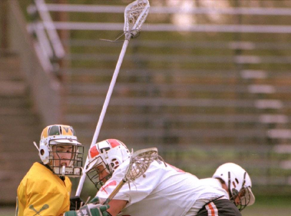 1997: While going for the ball Vestal's Eric Alexander is knocked to the ground by Union-Endicott's Mike Wilson during the Lacrosse game held Tuesday evening at Ty Cobb Field at Union-Endicott High School.
