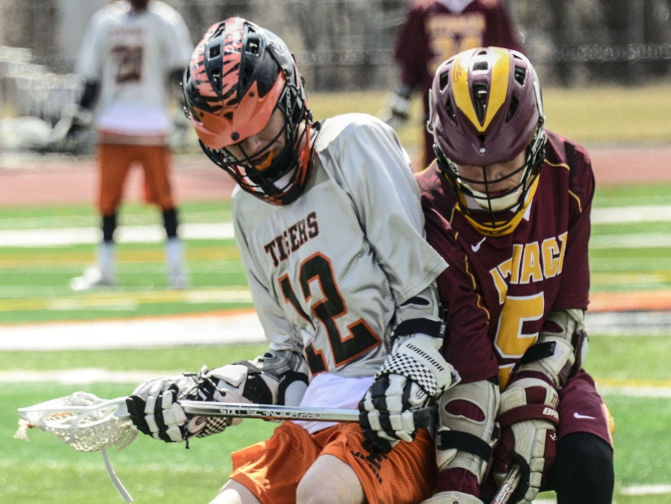 Ithaca's Aidan McMarthy and Union-Endicott's Eirk Legenhausen fight for control of the ball during a boys lacrosse game.