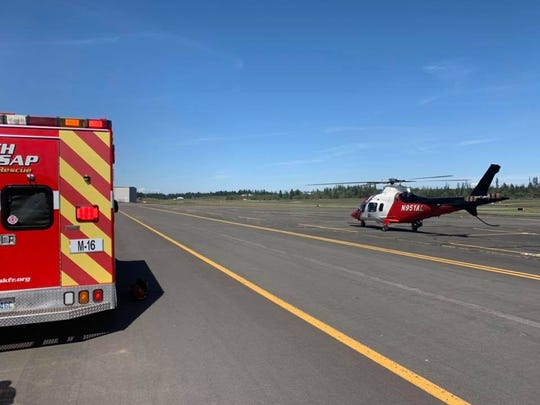 South Kitsap firefighters tweeted this image of the Airlift Northwest helicopter at Bremerton National Airport. One person has been transported to Harborview Medical Center with serious injuries.