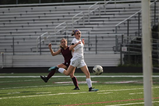 Owen junior Camryn Bolick scores a goal against Smoky Mountain the first half of an 8-2 Warlassies home victory on May 6.