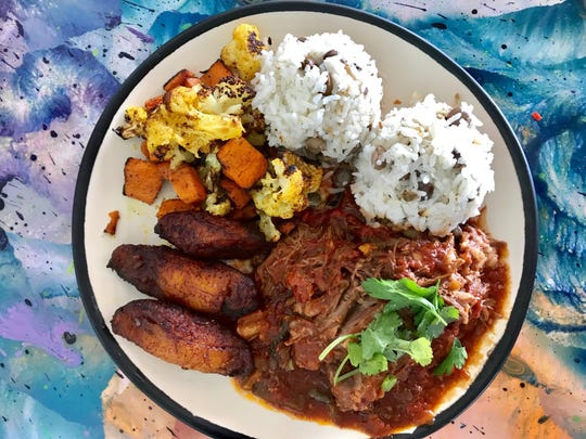 The menu at Junkanoo at Port Canaveral features island favorites such as ropa vieja.