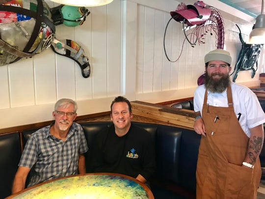 The management team at Junkanoo Island Kitchen & Rum Bar at Port Canaveral includes, from left, owner Gary Foreman, manager Steve Partsch and head chef Timothy Riley.