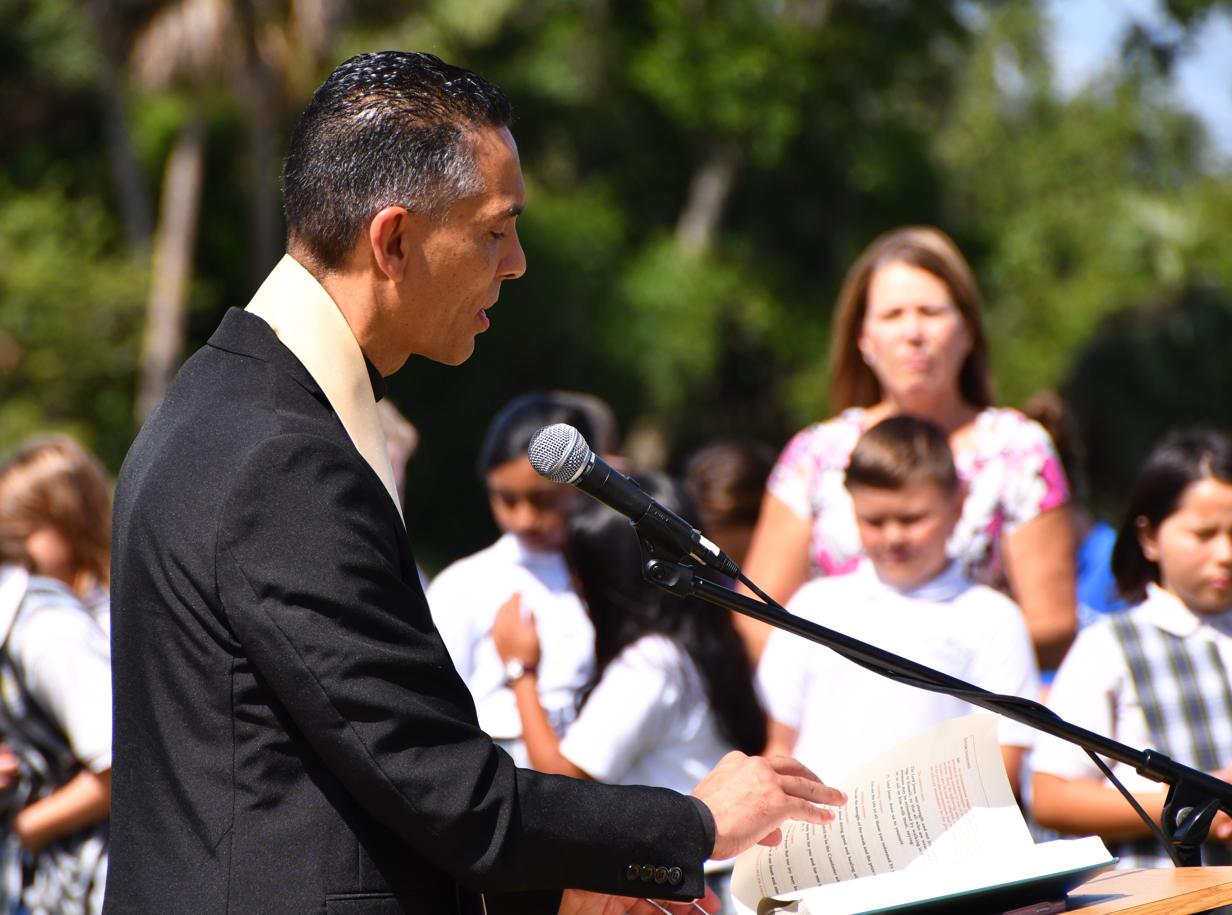 Very Rev. Ivan Olmosaid a prayer and spoke to the group before blessing the structures. St. Mary Catholic School in Rockledge hosted a dedication ceremony for its newly constructed shade structures Wednesday morning made possible by a grant from the American Academy of Dermatology's Adopt-A-Shade program. Board-certified dermatologist, Francille MacFarland, MD, FAAD, provided a generous donation to the AAD, which completed the funding necessary to build the structure over the school's primary playground and picnic area. The shade will help protect more than 250 children and teachers daily from the sun's harmful ultraviolet rays. Other parishioners, families, doctors and school fund raisers helped cover the cost.