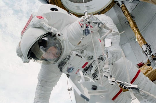 Astronaut Story Musgrave performs the first EVA of the space shuttle program on April 7, 1983, during STS-6.