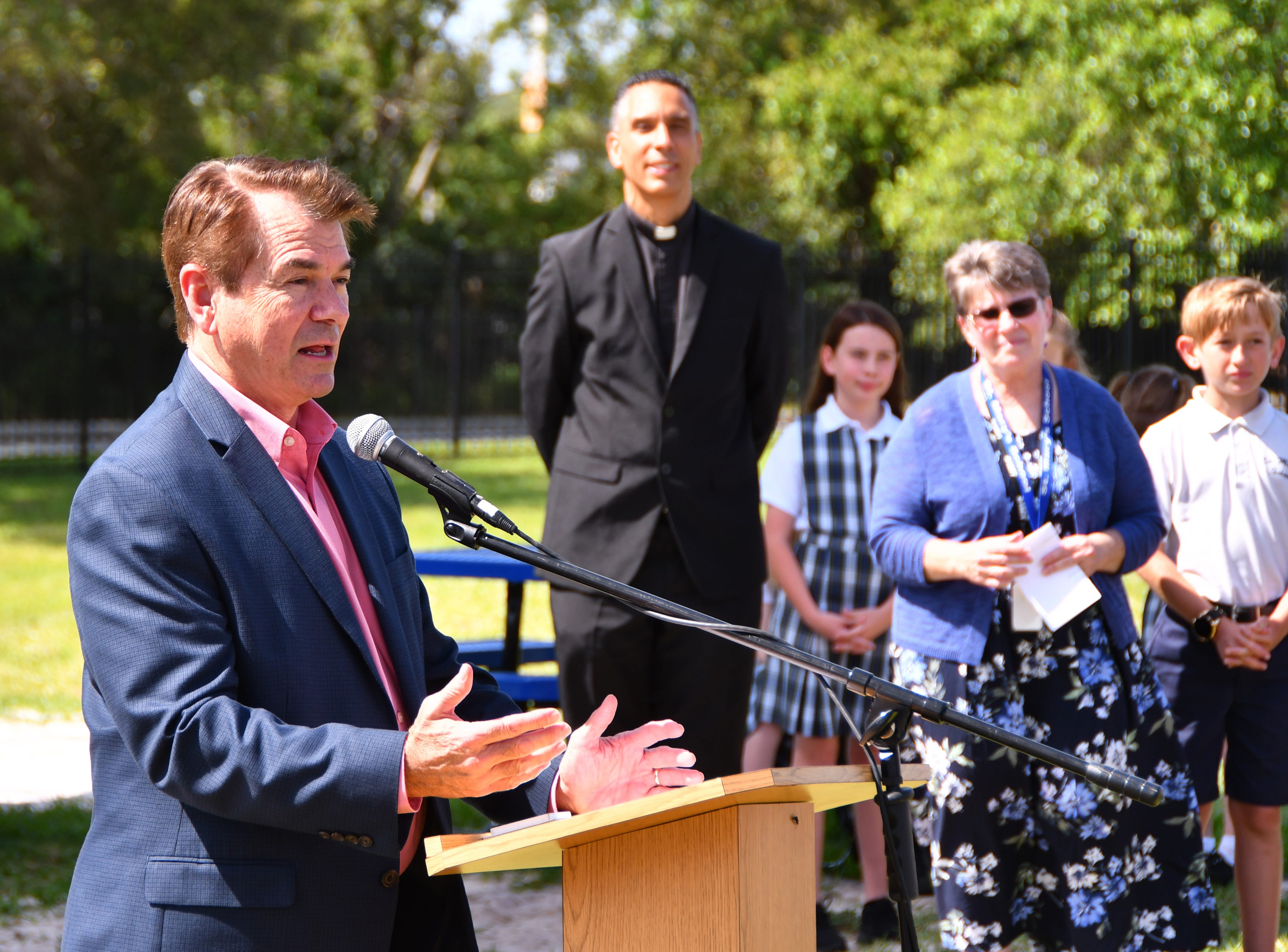 State Rep. Thad Altman, who attended St. Mary, was one of the speakers. St. Mary Catholic School in Rockledge hosted a dedication ceremony for its newly constructed shade structures Wednesday morning made possible by a grant from the American Academy of Dermatology's Adopt-A-Shade program. Board-certified dermatologist, Francille MacFarland, MD, FAAD, provided a generous donation to the AAD, which completed the funding necessary to build the structure over the school's primary playground and picnic area. The shade will help protect more than 250 children and teachers daily from the sun's harmful ultraviolet rays. Other parishioners, families, doctors and school fund raisers helped cover the cost.