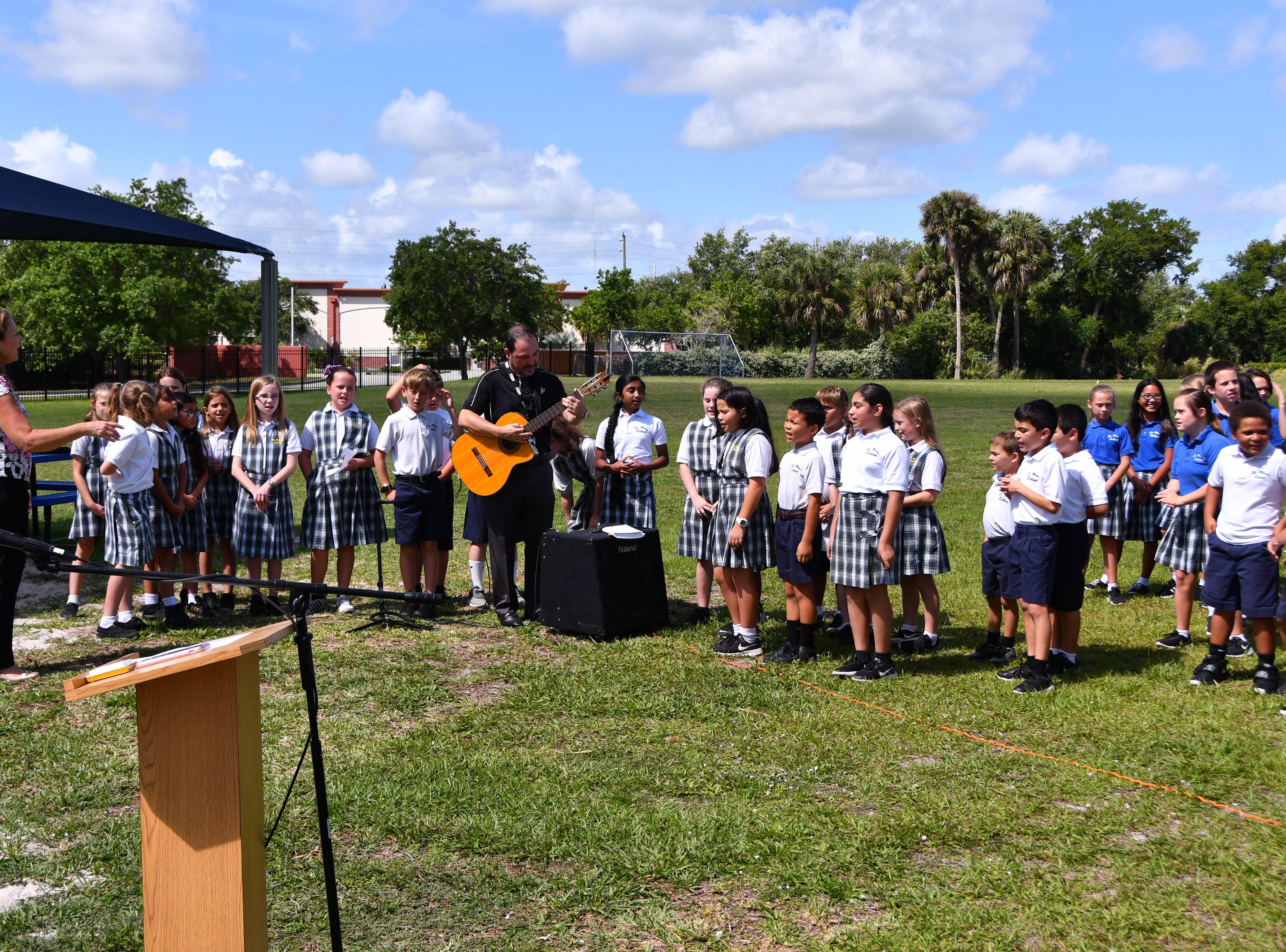 The school choir sang for the event.  St. Mary Catholic School in Rockledge hosted a dedication ceremony for its newly constructed shade structures Wednesday morning made possible by a grant from the American Academy of DermatologyÕs Adopt-A-Shade program. Board-certified dermatologist, Francille MacFarland, MD, FAAD, provided a generous donation to the AAD, which completed the funding necessary to build the structure over the schoolÕs primary playground and picnic area. The shade will help protect more than 250 children and teachers daily from the sunÕs harmful ultraviolet rays. Other parishioners, families, doctors and school fund raisers helped cover the cost.