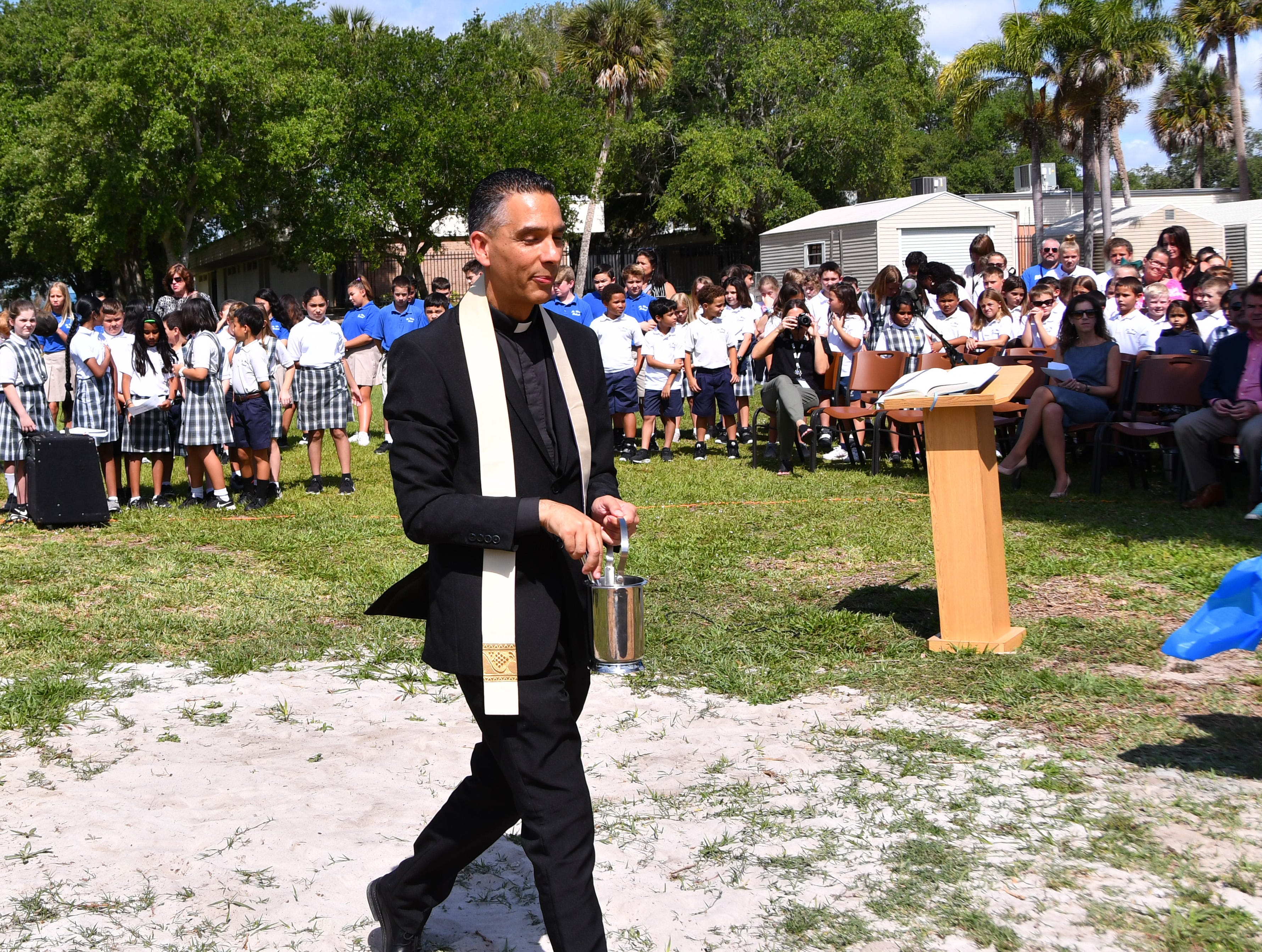 Very Rev. Ivan Olmo spoke to the group  before blessing the structures. St. Mary Catholic School in Rockledge hosted a dedication ceremony for its newly constructed shade structures Wednesday morning made possible by a grant from the American Academy of Dermatology's Adopt-A-Shade program. Board-certified dermatologist, Francille MacFarland, MD, FAAD, provided a generous donation to the AAD, which completed the funding necessary to build the structure over the school's primary playground and picnic area. The shade will help protect more than 250 children and teachers daily from the sun's harmful ultraviolet rays. Other parishioners, families, doctors and school fund raisers helped cover the cost.