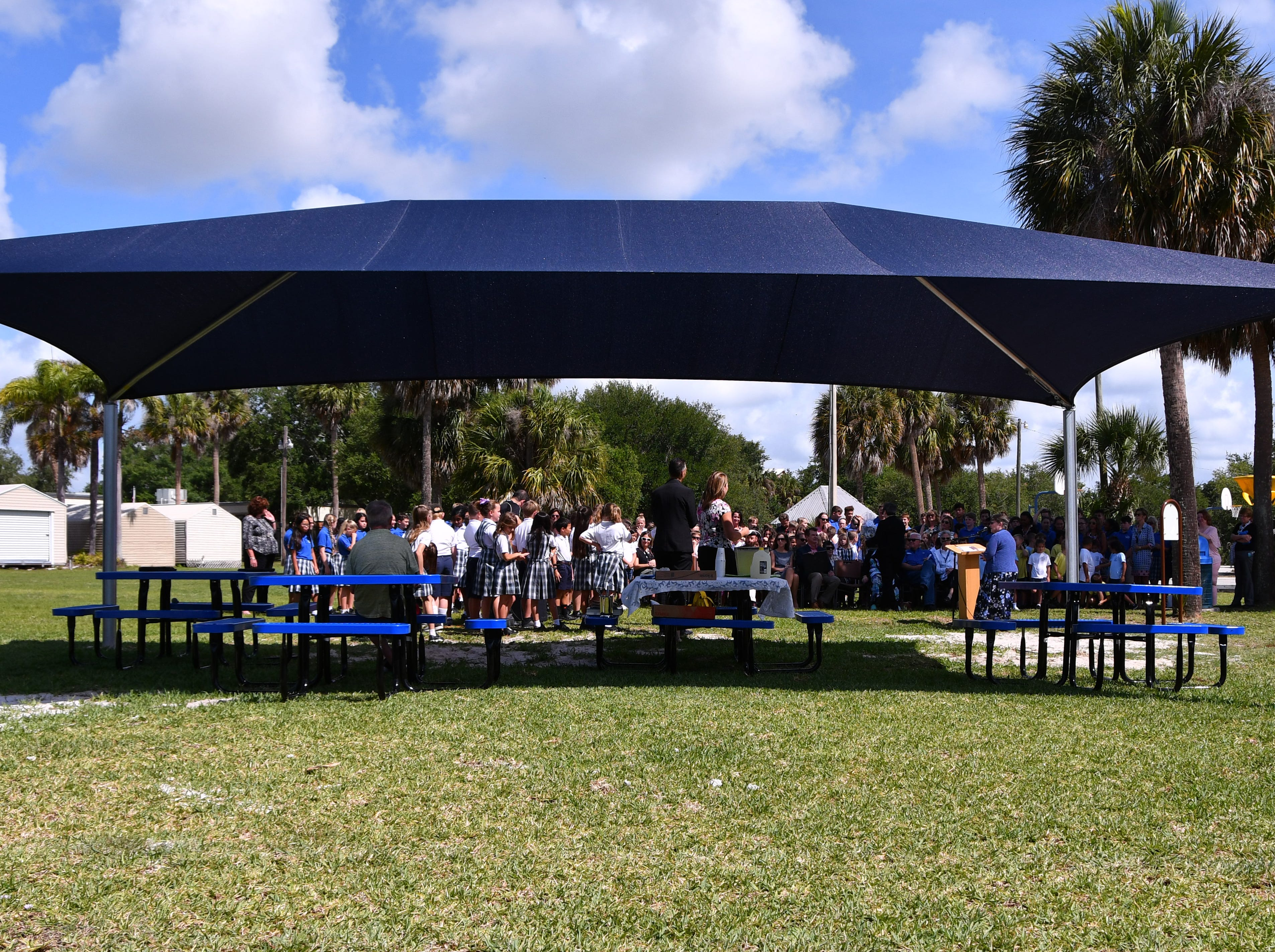 St. Mary Catholic School in Rockledge hosted a dedication ceremony for its newly constructed shade structures Wednesday morning made possible by a grant from the American Academy of Dermatology's Adopt-A-Shade program. Board-certified dermatologist, Francille MacFarland, MD, FAAD, provided a generous donation to the AAD, which completed the funding necessary to build the structure over the school's primary playground and picnic area. The shade will help protect more than 250 children and teachers daily from the sun's harmful ultraviolet rays. Other parishioners, families, doctors and school fund raisers helped cover the cost.