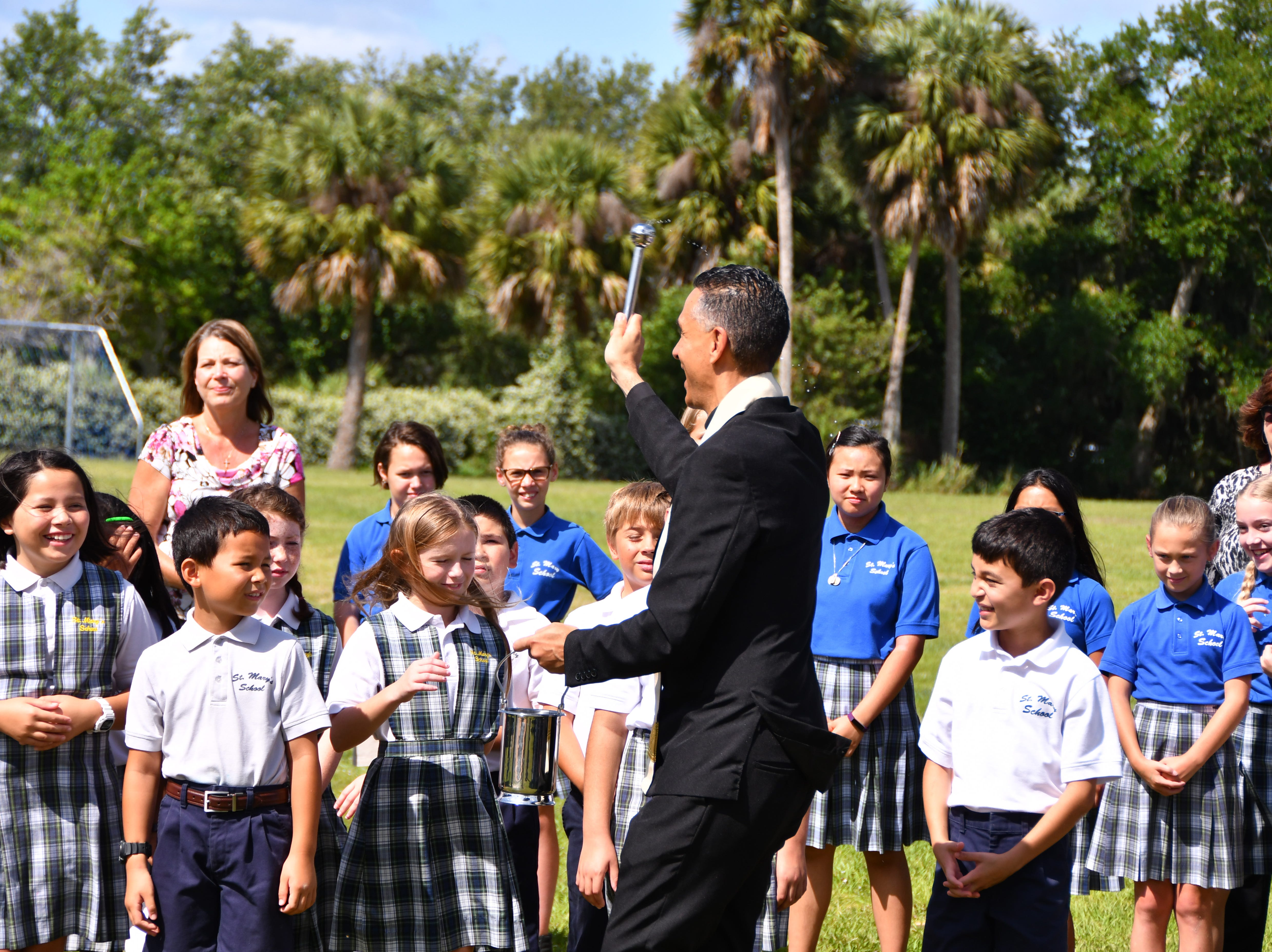 Very Rev. Ivan Olmo spoke to the group  before blessing the structures and the crowd. St. Mary Catholic School in Rockledge hosted a dedication ceremony for its newly constructed shade structures Wednesday morning made possible by a grant from the American Academy of Dermatology's Adopt-A-Shade program. Board-certified dermatologist, Francille MacFarland, MD, FAAD, provided a generous donation to the AAD, which completed the funding necessary to build the structure over the school's primary playground and picnic area. The shade will help protect more than 250 children and teachers daily from the sun's harmful ultraviolet rays. Other parishioners, families, doctors and school fund raisers helped cover the cost.