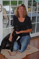 Soggy Doggy founder Joanna Rein with Buddy, the inspiration for her company.