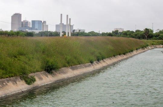 The outline of Corpus Christi's downtown can be seen easily from the levee off W. Broadway Street. The levees are part of the city's flood protection system, intended to guard downtown from storm surge coming up through the inner harbor. Engineers say they are at risk for failure during a storm and must be fortified.