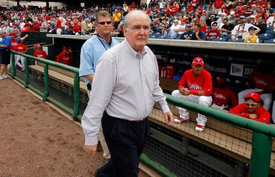 FILE - In this March 10, 2011, file photo, Philadelphia Phillies President and CEO David Montgomery, right, visits Bright House Field before a spring training baseball game against the New York Yankees in Clearwater, Fla.  The Phillies say the team's chairman has passed away after a lengthy battle with cancer. David Montgomery was 72. The MLB team announced his death Wednesday, May 8, 2019. (AP Photo/Gene J. Puskar, File)