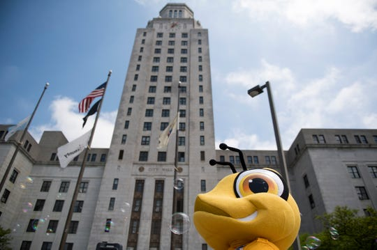 Bubbles float past Buzz of the Camden Special Services District outside City Hall Tuesday, May 7, 2019 as the new Connect the Lots programming is announced at Roosevelt Park in Camden, N.J.