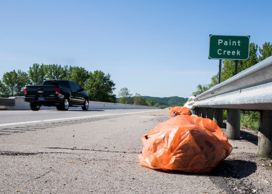 Trash bags filled by a prison litter pick-up crew are left on the side of U.S. 23 for ODOT officials to pick up later in the evening.