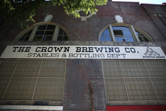 The building owners painted this structure on McMicken with signage of the historic breweries that used to operate there.