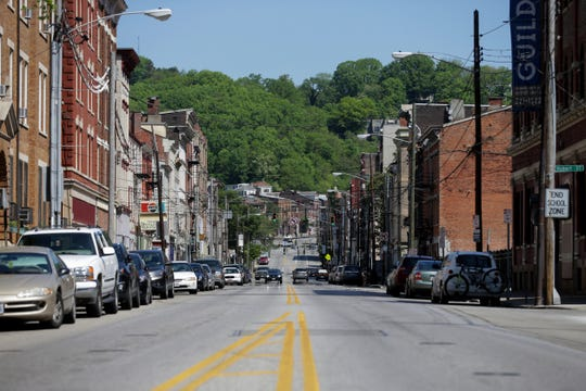 View looking north on Vine Street, north of Liberty Street, where dozens of saloons were located in the 1880s. The Brewing Heritage Trail offers people the opportunity to explore Cincinnati through an urban walking trail. Markers and public art  are part of the experience. The trail, pictured, Wednesday, May 8, 2019, winds through Over-the-Rhine.