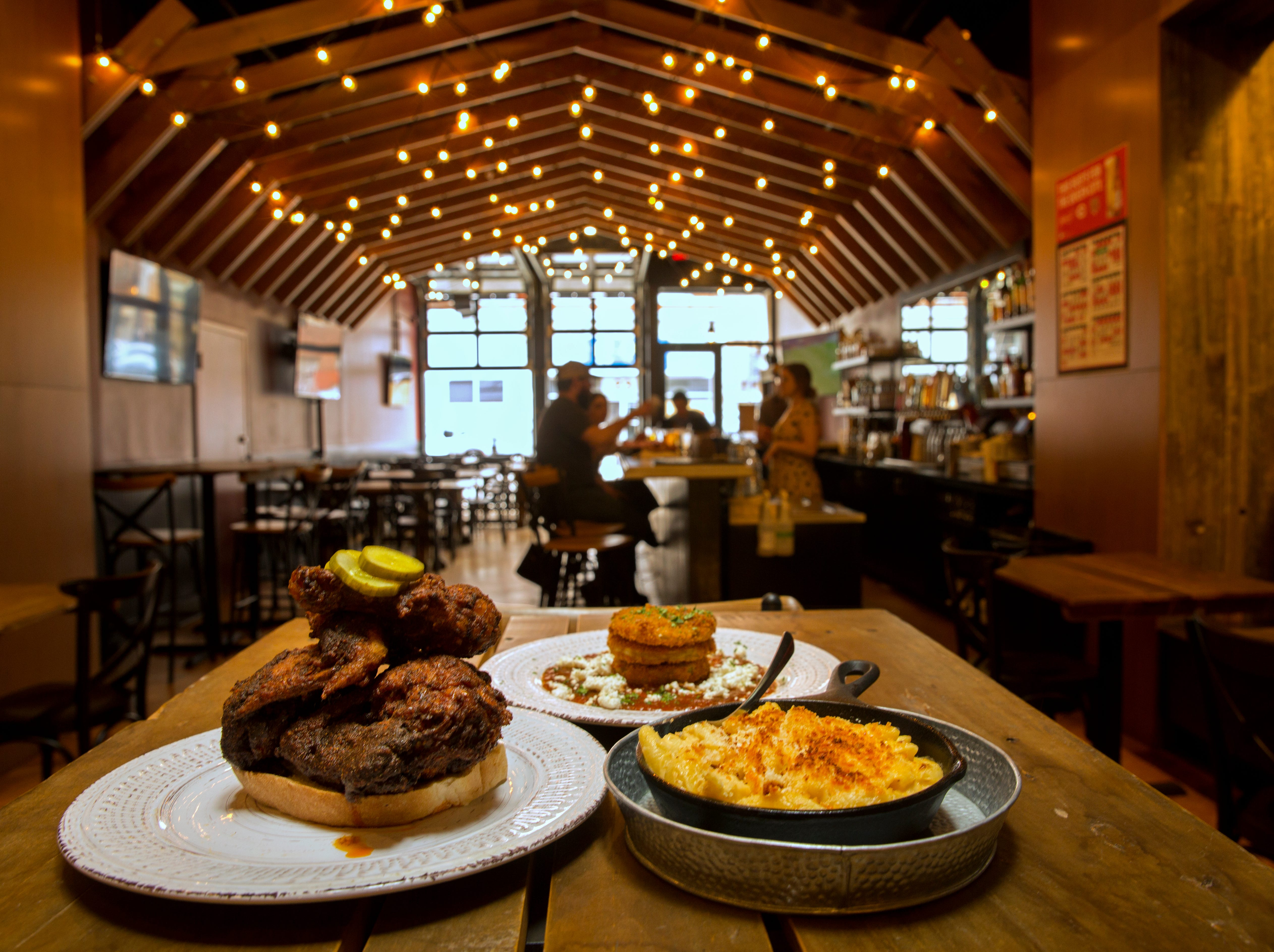 The Fiery Hen on Court Street between Race and Vine, opened in January of 2019. On their website, they say, 'they're bringing southern spice, aided by Cincy charm to the downtown corridor.' Dan Swormstedt is the owner. He also owns the Court Street Lobster Bar next door. Curtis Fowler is the general manager for both. Start with their fried green tomatoes with honey goat cheese, red sauce and parmesan. And then dig into the hot chicken, choosing from five spices levels, from Yella Belly to Bless Your Heart. And of course, try the Mac and cheese. Thirsty? They have a full bar. Court Street is undergoing its biggest change in years with the new 18-floor Kroger at Walnut Street. The 560-space garage is already opened. The grocery store will open in the fall and include a food court. The development will also have 139 apartments. Photographed May 1, 2019.