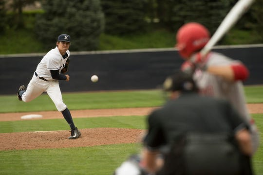 Xavier University pitcher Conor Grammes delivers a pitch earlier this season against Miami University. Grammes came to Xavier as a walk-on but he's since garnered the attention of Major League Baseball with scouts in attendance every time he takes the mound.