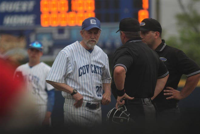 CovCath head coach Bill Krumpelbeck argues a call with two umpires as Beechwood defeated Covington Catholic 1-0 in baseball May 7, 2019 at Covington Catholic High School, Park Hills KY.
