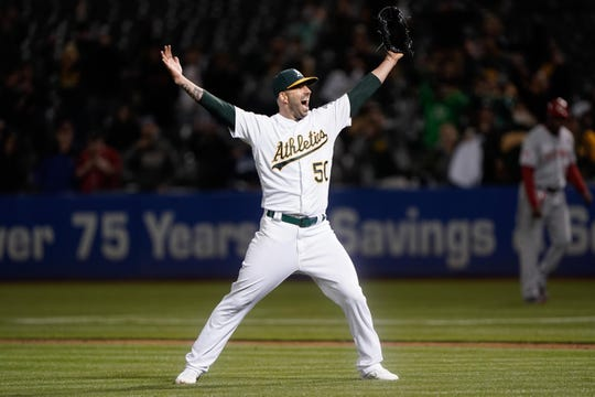 May 7, 2019; Oakland, CA, USA; Oakland Athletics starting pitcher Mike Fiers (50) celebrates after pitching a no hitter against the Cincinnati Reds at Oakland Coliseum. Mandatory Credit: Stan Szeto-USA TODAY Sports
