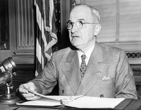 President Harry S Truman addresses the media in 1945 in Washington, D.C.