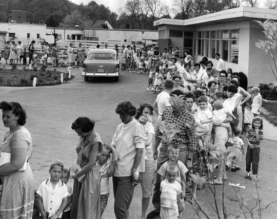 Parents and children lined up for the Sabin oral polio vaccine at Stratford Manor Clinic in Madisonville, April 26, 1960.