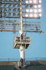 May 7, 2019; Oakland, CA, USA; Oakland Athletics maintenance workers climb the ladder to fix the lights causing a game delay against the Cincinnati Reds at Oakland Coliseum. Mandatory Credit: Stan Szeto-USA TODAY Sports