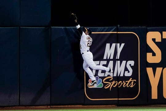 May 7, 2019; Oakland, CA, USA; Oakland Athletics center fielder Ramon Laureano (22) catches the ball and prevents a home run score by the Cincinnati Reds during the sixth inning at Oakland Coliseum. Mandatory Credit: Stan Szeto-USA TODAY Sports