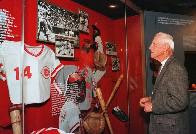 """Hall of Fame inductee Sparky Anderson views a display featuring artifacts from the Cincinnati Reds' 1975 and 1976 World Series wins at the National Baseball Hall of Fame and Museum on Tuesday, April 18, 2000. """"I didn't ever want to go into the most precious place in the world unless I belonged there,'' Anderson said after strolling the halls of the Baseball Hall of Fame for the first time. """"But I would have been sorry if I hadn't come here."""""""