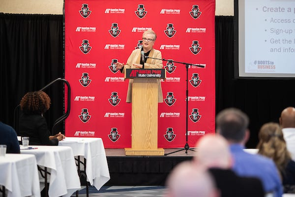 APSU President Alisa White speaks at a previous industry summit.