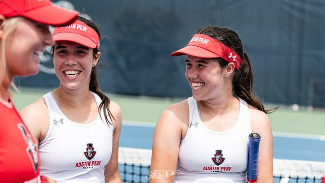 Lidia Yanes Garcia, left, and Claudia Yanes Garcia talk during the OVC championship
