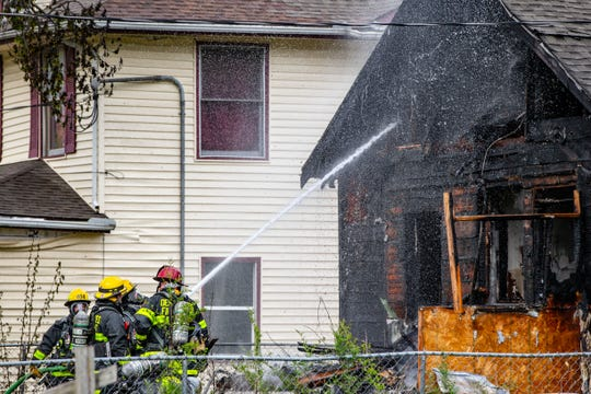 Firefighters respond a house fire at 1515 4th St. in Des Moines Wednesday, May 8, 2019.