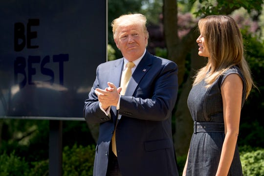 President Donald Trump applauds for first lady Melania Trump at the one-year anniversary event for the first lady's Be Best initiative in the Rose Garden of the White House on Tuesday.