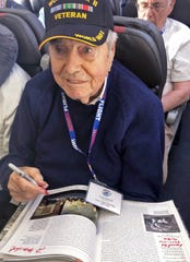 "This Sunday, May 5, 2019 photo from Honor Flight San Diego shows Frank Manchel, a 95-year-old former soldier, shortly before he died aboard an airliner bringing him home from a tour of Washington, D.C., on what's known as an Honor Flight for elderly veterans. Manchel collapsed about an hour before the chartered American Airlines jet was due to land in San Diego. Two physicians, including his own son, Dr. Bruce Manchel, were unable to revive him. Passengers sang ""God Bless America"" as the plane descended, and saluted his body as they passed by on leaving the plane. (Pha Lee/Honor Flight San Diego via AP)"