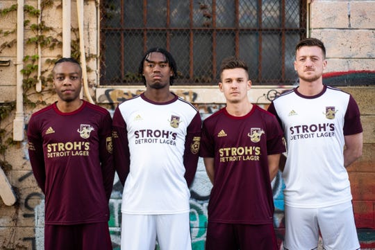 Detroit City Football Club is introducing new jerseys this year, featuring Stroh's beer brand on them. The company, originally established in 1850, was named the team's 2019 title partner. Pictured (from left) are forward Shawn Lawson, defender Omar Sinclair, midfielder Bakie Goodman and defender Stephen Carroll.