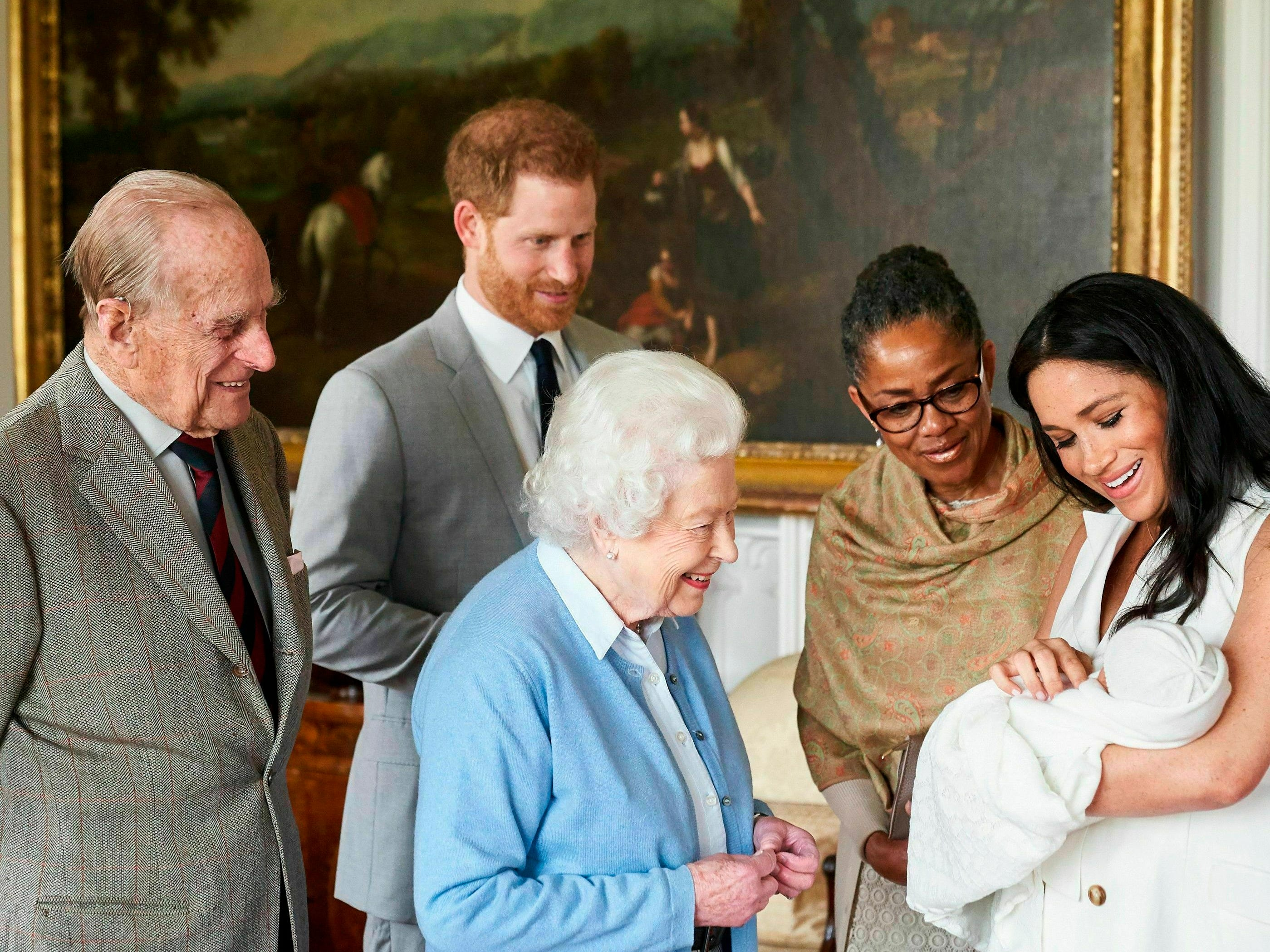 Britain's Prince Harry and Meghan, duchess of Sussex, with her mother Doria Ragland, show their newborn son to Queen Elizabeth II and Prince Philip on Wednesday May 8, 2019 at Windsor Castle, England. Prince Harry and Meghan have named their son Archie Harrison Mountbatten-Windsor.